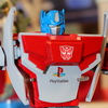 Transformers Optimus Prime and Megatron as Playstation and Sega Master System